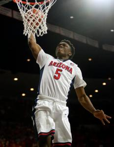 Arizona forward Stanley Johnson (5) dunks against Southern California during the second half of an NCAA college basketball game, Thursday, Feb. 19, 2015, in Tucson, Ariz. (AP Photo/Rick Scuteri)